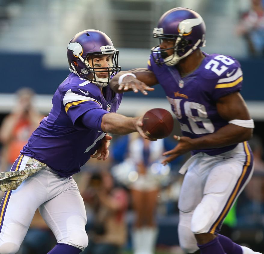 Minnesota Vikings quarterback Christian Ponder (7) passes the football to  Adrian Peterson (28) during the second half of an NFL football game Sunday, Nov. 3, 2013, in Arlington, Texas. (AP Photo/Waco Tribune Herald/ Jose Yau)