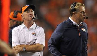 Denver Broncos head coach John Fox, left, defensive coordinator Jack Del Rio and look on against the Baltimore Ravens during an NFL football game, Thursday, Sept. 5, 2013, in Denver. (AP Photo/Jack Dempsey)