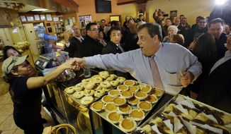 New Jersey Gov. Chris Christie greets workers at Oasis Pastry Shop during a campaign stop in Hillside, N.J., on Monday, Nov. 4, 2013. Mr. Christie will face Democratic gubernatorial candidate Barbara Buono at the polls on Tuesday. (AP Photo/Mel Evans)