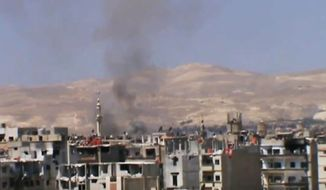 ** FILE ** Black smoke billows into the air from heavy shelling in Daraya, Syria, in Greater Damascus, on Monday, Nov. 4, 2013. (AP Photo/Shaam News Network via AP video)