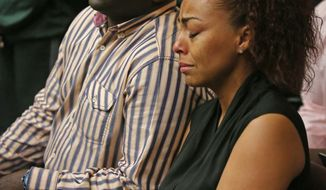 Pedro Taylor, father of Sean Taylor,  sits listening to the verdict in the trial of Eric Rivera Jr. Monday Nov. 4, 2013 in Miami.  Rivera was found guilty of second degree murder in the death of his son Sean Taylor.Woman at right not identified.   (AP Photo/The Miami Herald, Walter Michot, Pool)  no sales