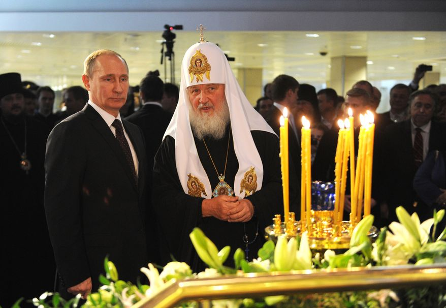 """Russian President Vladimir Putin, left, and Russian Orthodox Church Patriarch Kirill visit an exhibition, """"Orthodox Russia and the Romanovs,"""" devoted to the 400-year anniversary of Russian Emperor family rule, in Moscow, Russia, Monday, Nov. 4, 2013. (AP Photo/RIA Novosti, Alexei Nikolsky, Presidential Press Service)"""