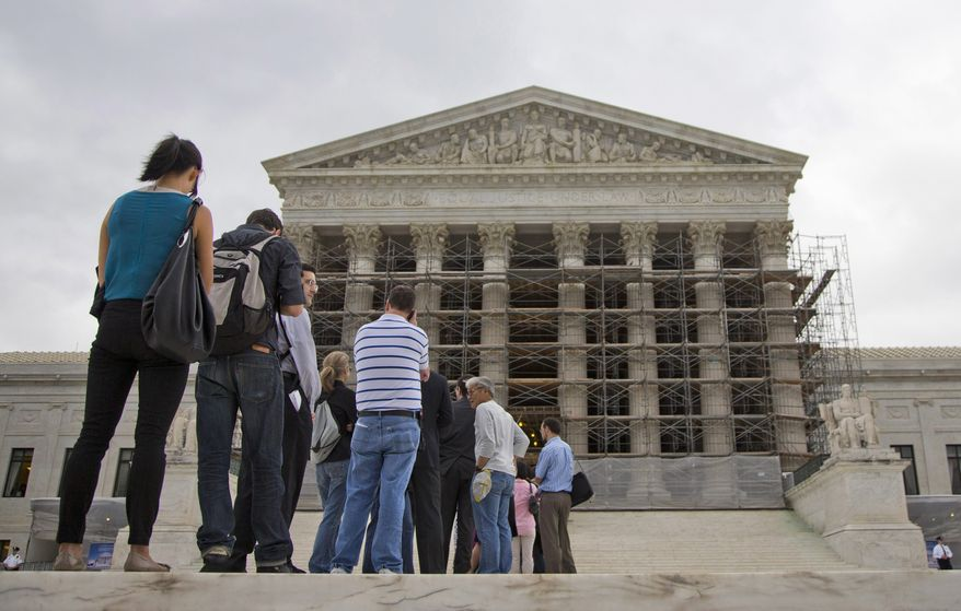 ** FILE ** This Oct. 7, 2013, file photo shows people wait in line to enter the Supreme Court in Washington. (AP Photo/ Evan Vucci, File)