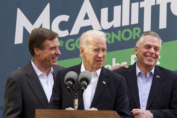 Vice President Joseph R. Biden (center), accompanied by Sen. Mark Warner (left), speaks at a campaign event for Virginia Democratic gubernatorial candidate Terry McAuliffe (right) on Monday, Nov. 4, 2013, in Annandale, Va. On Tuesday, Virginia voters will go to the polls to choose between Mr. McAuliffe and state Attorney General Kenneth T. Cuccinelli II as the next governor. (AP Photo/Jacquelyn Martin)