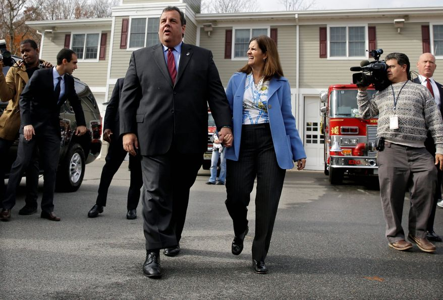 New Jersey Gov. Chris Christie and his wife, Mary Pat, leave the poll in Mendham Township after voting Tuesday. Mr. Christie easily won a second term. (Associated Press photographs)