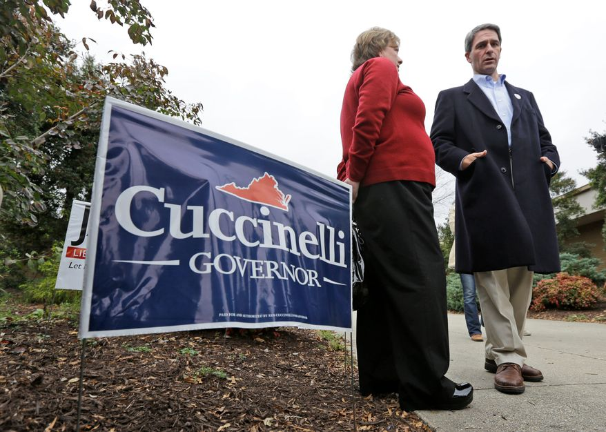Virginia Attorney General Kenneth T. Cuccinelli II, the Republican candidate for governor, talks to voters at the Atlee High School voting place in Hanover on Tuesday.