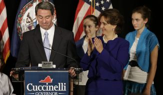 Republican gubernatorial candidate, Virginia Attorney General Ken Cuccinelli, delivers his concession speech with his wife, Teiro, during a rally in Richmond, Va., Tuesday, Nov. 5, 2013. Cuccinelli was defeated by Democrat Terry McAuliffe. (AP Photo/Steve Helber)