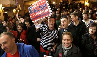 Martin Davis, of Weymouth, Mass., center, a Martin Walsh supporter, holds a placard while reacting to televised returns in the race for mayor of Boston during a watch party at a hotel in Boston, Tuesday, Nov. 5, 2013. Mass. State Rep. MartinWalsh, D-Boston, and City Councilor John Connolly are running for the office held by Boston Mayor Thomas Menino for more than two decades. (AP Photo/Steven Senne)