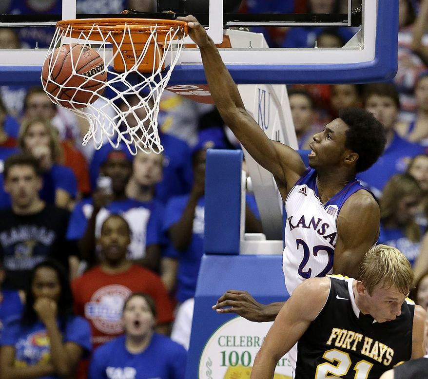 Kansas' Andrew Wiggins (22) gets past Fort Hays State's Jake Stoppel to dunk the ball during the second half of an exhibition NCAA college basketball game Tuesday, Nov. 5, 2013, in Lawrence, Kan. Kansas won the game 92-75. (AP Photo/Charlie Riedel)