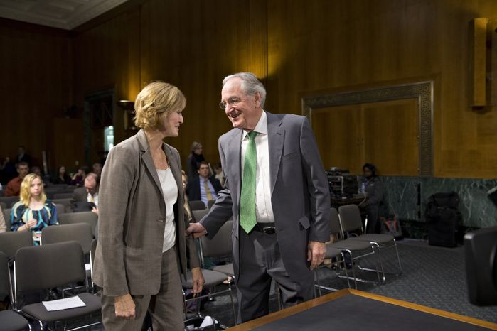 Sen. Tom Harkin, chairman of the Senate Health, Education, Labor and Pensions Committee, greets Medicare chief Marilyn Tavenner on Capitol Hill in Washington on Tuesday, Nov. 5, 2013, prior to her testimony before the committee on problems with the debut of the Affordable Care Act. (AP Photo/J. Scott Applewhite)