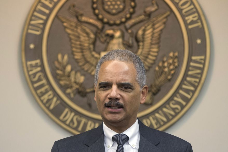 Attorney General Eric H. Holder Jr. speaks during a news conference on Tuesday, Nov. 5, 2013, at the U.S. Courthouse in Philadelphia. (AP Photo/Matt Rourke)