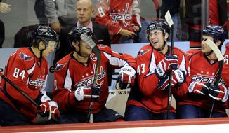 Washington Capitals right wing Tom Wilson (43) reacts on the bench after he scored a goal with teammates Mikhail Grabovski (84), of Germany, Alex Ovechkin (8), of Russia, and Aaron Volpatti, right, against the New York Islanders during the third period an NHL hockey game, Tuesday, Nov. 5, 2013, in Washington. The Capitals won 6-2. (AP Photo/Nick Wass)