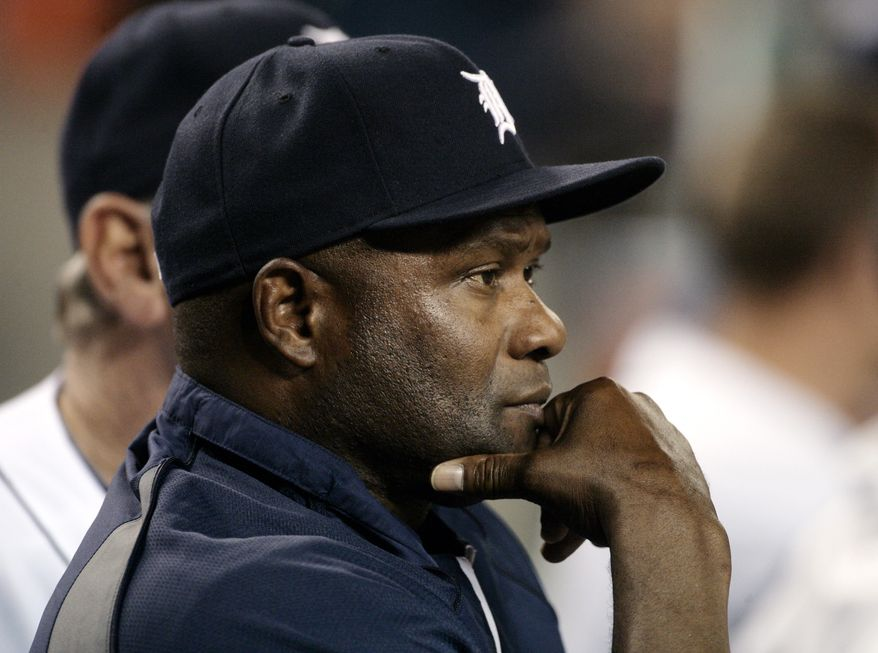 In this May 29, 2011, photo, Detroit Tigers hitting coach Lloyd McClendon watches from the dugout during the Tigers' baseball game against the Boston Red Sox in a doubleheader in Detroit. The Seattle Mariners have hired McClendon to be their next manager. The Mariners announced their decision on Tuesday, Nov. 5, 2013. McClendon becomes the third manager hired by general manager Jack Zduriencik. McClendon will be formally introduced by the team later this week. (AP Photo/Duane Burleson)