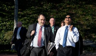 ** FILE ** President Barack Obama laughs while walking with senior adviser David Axelrod following an event at the Costa Mesa Town Hall at OC Fair & Event Center in Costa Mesa, Calif., March 18, 2009. (Official White House Photo by Pete Souza)