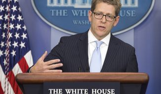 White House press secretary Jay Carney answers question about the implementation of the new health care law during the daily press briefing at the White House in Washington, Tuesday, Nov. 5, 2013. (AP Photo/ Evan Vucci)