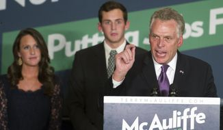 Virginia Democratic Gov.-elect Terry McAuliffe address his supporters, as his daughter Dori, 21, and  son Jack, 20, look on, at a victory party in Tysons Corner, Va., Tuesday, Nov. 5, 2013. (AP Photo/Cliff Owen)