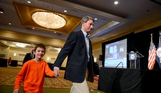 Republican candidate for Virginia Governor Ken Cuccinelli walks through the room where his election night party will be held an hour before polls close with his son Jack in downtown Richmond, Va., Tuesday, November 5, 2013. (Andrew Harnik/The Washington Times)