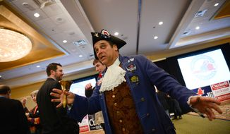 John Wallmeyer of Hannover County, Va., a Patrick Henry impersonator, rings a bell as he and other supporters of Republican candidate for Virginia Gov. Ken Cuccinelli watch election results on television at an election night party in downtown Richmond, Va., Tuesday, Nov. 5, 2013. (Andrew Harnik/The Washington Times) ** FILE **