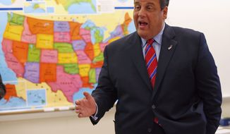 New Jersey Gov. Chris Christie visits a school a day after his landslide win. Tea partyers say the Republican National Committee spent money on his campaign that should have gone to Kenneth T. Cuccinelli II in Virginia. (Associated Press)