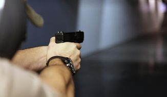 Supporters of the Concealed Carry Reciprocity Act say it would give law-abiding citizens the ability to protect themselves when they travel, but critics say it eviscerates states' rights to uphold their own firearms standards by allowing gun owners who obtain permits in states with lesser requirements to carry in all 50 states. (Associated Press/File)