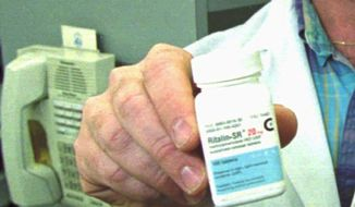 A pharmacist at Marquier's Pharmacy in Newark, N.J., holds a bottle of the prescription drug Ritalin on March 26, 1996. Ritalin, manufactured by Ciba Pharmaceuticals based in Summit, N.J., is prescribed for hyperactivity in children but has been abused by some adolescents who take larger quantities to get high. (Associated Press) ** FILE **