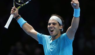 Rafael Nadal of Spain celebrates after winning the ATP World Tour Finals singles tennis match against Stanislas Wawrinka of Switzerland at the O2 Arena in London Wednesday, Nov. 6, 2013. (AP Photo/Sang Tan)