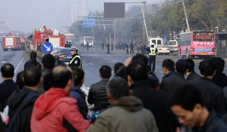 Residents gather near the site of multiple explosions outside the provincial headquarters of China's ruling Communist Party in Taiyuan in the nation's Shanxi province on Wednesday, Nov. 6, 2013. The provincial government and police said the blasts, which killed one and injured eight, struck at about 7:40 a.m. local time (6:40 p.m. EST Tuesday). (AP Photo)
