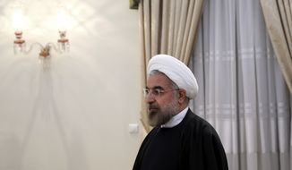 Iran's President Hassan Rouhani at his office ahead of a meeting with FIFA president Joseph Sepp Blatter in Tehran, Iran, Wednesday Nov. 6, 2013. Blatter met with Rouhani before flying to the Final of the FIFA U-17 World Cup in the UAE. (AP Photo/Ebrahim Noroozi)