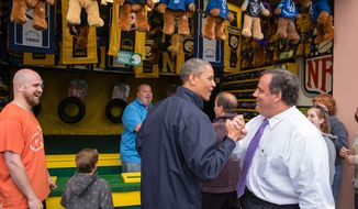 "President Barack Obama congratulates New Jersey Governor Chris Christie while playing the ""TouchDown Fever"" arcade game along the Point Pleasant boardwalk in Point Pleasant Beach, N.J., May 28, 2013. (Official White House Photo by Pete Souza)"