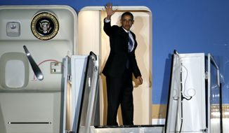 President Barack Obama waves as he boards Air Force One for departure from Love Field Airport, Wednesday, Nov. 6, 2013, in Dallas. (AP Photo/Tony Gutierrez)