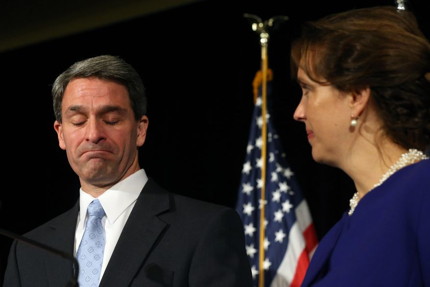 Republican Ken Cuccinelli shows defeat as his wife, Teiro, right, looks on as he gives his concession speech in Richmond, Va.,  after losing the governor's race to Democrat Terry McAuliffe Tuesday, Nov. 5, 2013. (AP Photo/Richmond Times-Dispatch, Bob Brown).