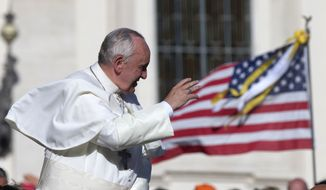 Pope Francis is driven away at the end of his weekly general audience in St. Peter's Square at the Vatican on Wednesday, Nov. 6, 2013. (AP Photo/Alessandra Tarantino)