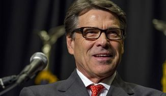 ** FILE ** Texas Gov. Rick Perry speaks at the Polk County Republican Party fall fundraiser dinner at the Embassy Suites in Des Moines, Iowa, on Thursday, Nov. 7, 2013. Perry returned to Iowa for the first time since his presidential run last year. (AP Photo/Justin Hayworth)