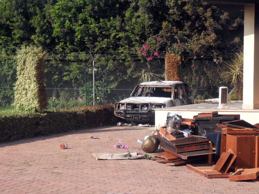 Exterior of the QRF villa the morning after the Benghazi attack with pile of  materials abandoned by looters. (Photo by Morgan Jones)