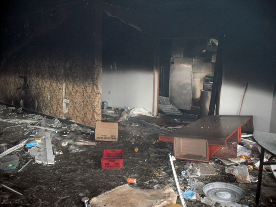 Benghazi compound burned out: The interior of the embassy canteen on the morning after the 2012 attack. (Photo by Morgan Jones)