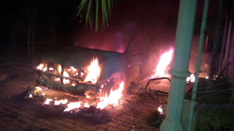 Armoured embassy SUV burning on the night of the Sept. 11, 2012 Benghazi attack at QRF villa. (Photo by Zahid Arman)