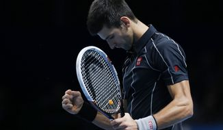 Novak Djokovic of Serbia celebrates his win against Juan Martin Del Potro of Argentina at the end of their ATP World Tour Finals single tennis match at the O2 Arena in London Thursday, Nov. 7, 2013. (AP Photo/Sang Tan)