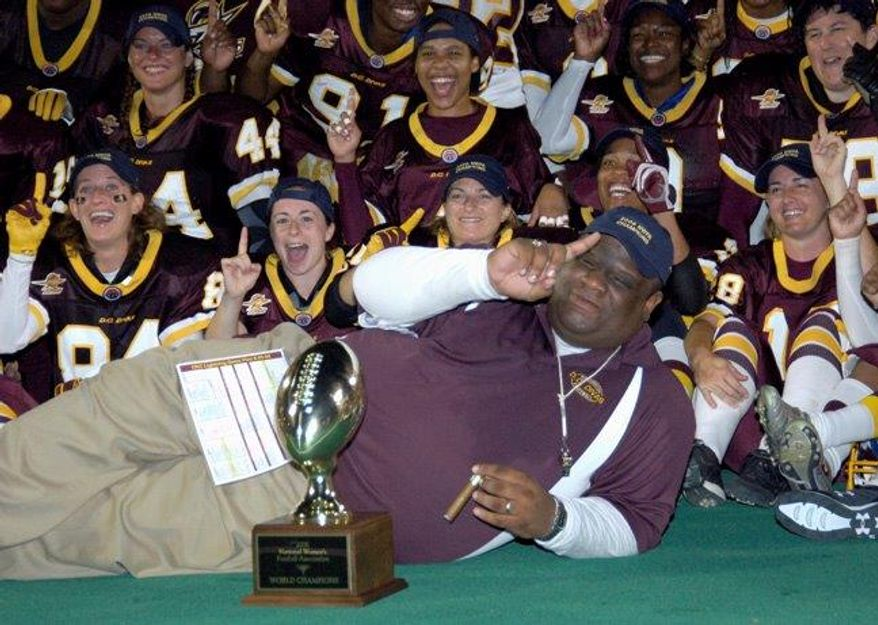 "D.C. Divas football coach Ezra Cooper is pictured with his team after they won the 2006 ""Super Bowl"" title. (D.C. Divas/Dan Rosenstein)"