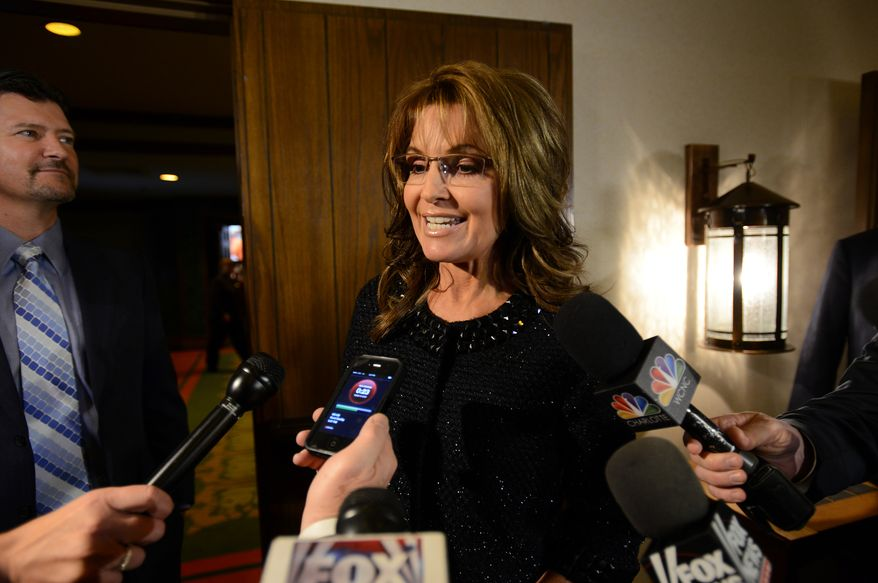 Former Alaska Gov. Sarah Palin, the 2008 Republican vice presidential nominee, talks to the media before the Rev. Billy Graham's 95th birthday party at the Grove Park Inn in Asheville, N.C., on Thursday, Nov. 7, 2013. (AP Photo/The Asheville Citizen-Times, Erin Brethauer)