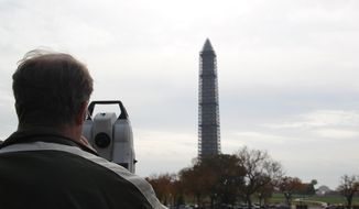 The National Oceanic and Atmospheric Administration has been performing a geodetic survey of the peak of the Washington Monument as the scaffolding begins to be dismantled. (Photo courtesy of the National Oceanic and Atmospheric Administration)