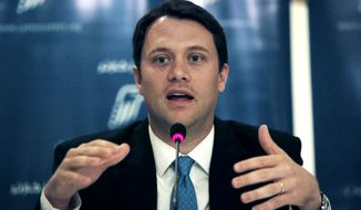 ** FILE ** In this June 19, 2012, file photo, Democratic Georgia state Sen. Jason Carter talks during a news conference for the Carter Center's election witnessing mission in Egypt, in Cairo. Carter, the grandson of former President Jimmy Carter, tells The Associated Press Thursday Nov. 7, 2013, he plans to run for governor of Georgia next year. (AP Photo/Nasser Nasser, File)