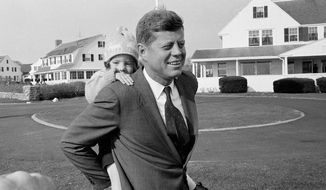 ** FILE ** In this Nov. 9, 1960, file photo, Caroline Kennedy gets a piggy-back ride from her father, Sen. John F. Kennedy, in Hyannis Port, Mass. It was the first chance in weeks Kennedy has had to relax with his daughter during his presidential campaign. (AP Photo)