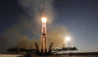 The Soyuz-FG rocket booster with Soyuz TMA-11M space ship carrying a new crew to the International Space Station (ISS) blasts off at the Russian leased Baikonur cosmodrome, Kazakhstan, Thursday, Nov. 7, 2013. The Russian rocket carries Japanese astronaut Koichi Wakata, Russian cosmonaut Mikhail Tyurin and U.S. astronaut Rick Mastracchio who will deliver an Olympic torch to space as part of the ongoing Olympic torch relay. The torch will be brought back along with the station's current crew. (AP Photo/Dmitry Lovetsky)