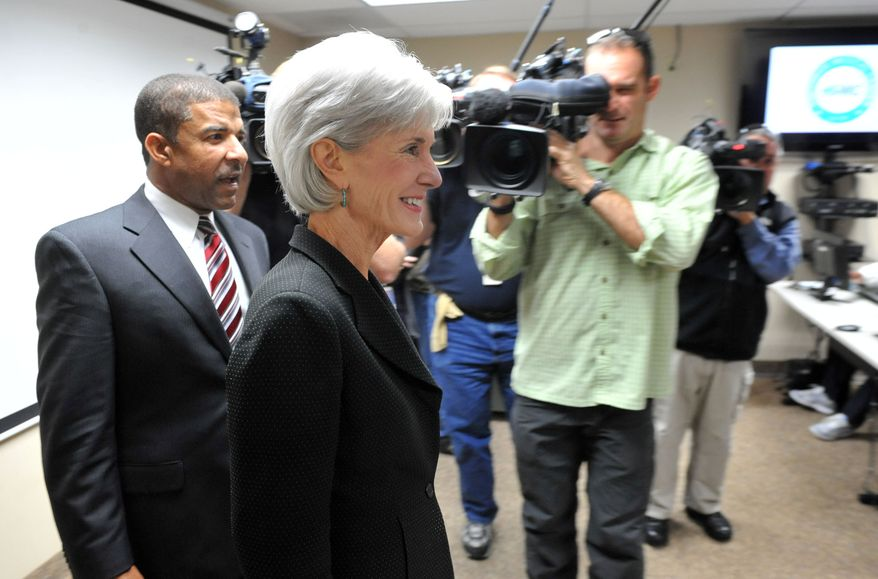 ** FILE ** Health and Human Services Secretary Kathleen Sebelius enters the navigator room with Southside Medical Center CEO Dr. David Williams on Friday, Nov. 8, 2013 in Atlanta. (AP Photo/Atlanta Journal-Constitution, Kent D. Johnson)