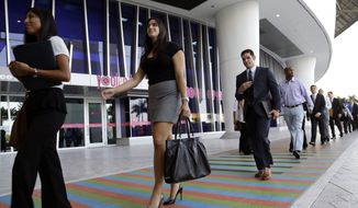 ** FILE ** In this Wednesday, Oct. 23, 2013, file photo, job applicants arrives for an internship job fair held by the Miami Marlins, at Marlins Park in Miami. The government issued the October jobs report, on Friday, Nov. 8, 2013, which had been delayed a week because of the government shutdown. ( AP Photo/Lynne Sladky, File)