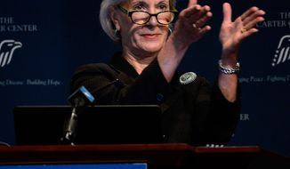 Department of Health and Human Services Secretary Kathleen Sebelius applauds as she announces easier access to mental health care during an address to former First Lady Rosalynn Carter's 29th annual mental health policy symposium at the Carter Center on Friday, Nov. 8, 2013, in Atlanta. (AP Photo/David Tulis)