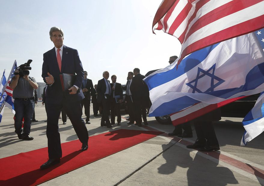 "U.S. Secretary of State John Kerry walks to his plane after meeting with Israeli Prime Minister Benjamin Netanyahu in Tel Aviv, Israel, Friday, Nov. 8, 2013. Netanyahu, before meeting with Kerry, said Friday that he ""utterly rejects"" the emerging nuclear deal between western powers and Iran, calling it a ""bad deal"" and promising that Israel will do everything it needs to do to defend itself. (AP Photo/Jason Reed, Pool)"