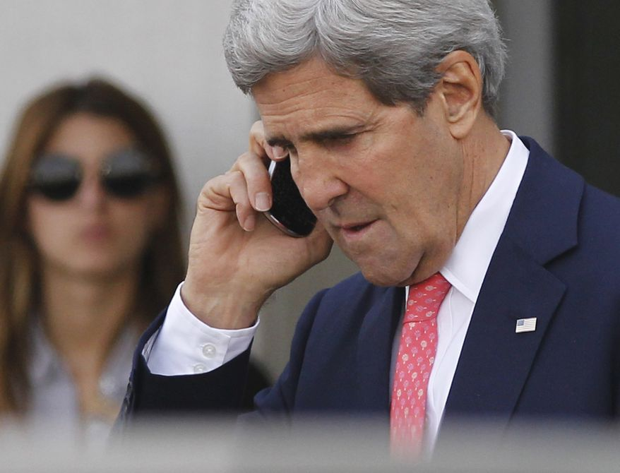 "U.S. Secretary of State John Kerry speaks on a mobilephone after meeting with Israeli Prime Minister Benjamin Netanyahu in Tel Aviv, Israel, Friday, Nov. 8, 2013. Netanyahu, before meeting with Kerry, said Friday that he ""utterly rejects"" the emerging nuclear deal between western powers and Iran, calling it a ""bad deal"" and promising that Israel will do everything it needs to do to defend itself. (AP Photo/Jason Reed, Pool)"