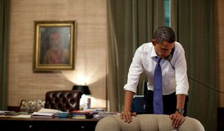 President Barack Obama talks on the phone in the Treaty Room Office in the White House residence. (Official White House Photo by Pete Souza)