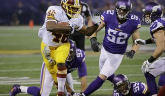 Washington Redskins running back Alfred Morris (46) leaves behind Minnesota Vikings players during the first half of an NFL football game Thursday, Nov. 7, 2013, in Minneapolis. (AP Photo/Ann Heisenfelt)